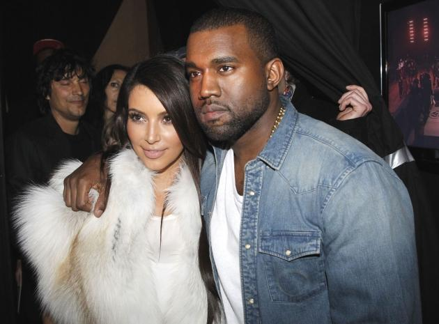 Kim Kardashian and Kanye West attend the Kanye West Ready-To-Wear Fall/Winter 2012 show as part of Paris Fashion Week at Halle Freyssinet in Paris on March 6, 2012 -- Getty Premium