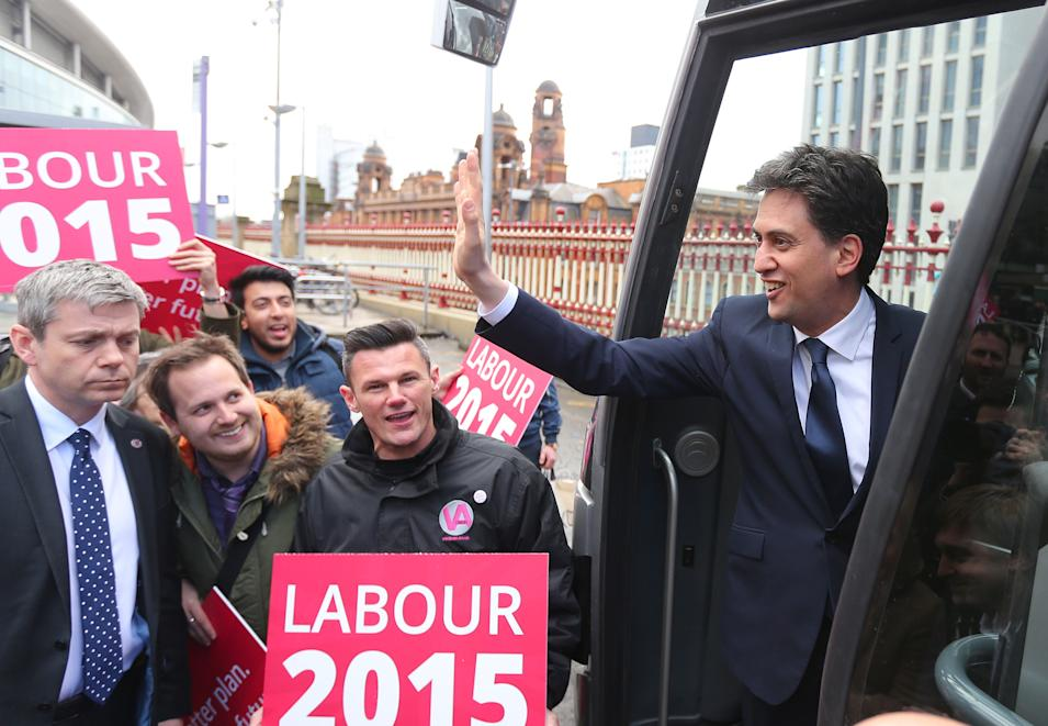 Labour Party Leader Ed Miliband waves to supporters from the party's General Election battle bus after arriving at Manchester Piccadilly stationin Manchester England  Tuesday March 31, 2015. Britain with hold a parliamentary election on Thursday May 7, 2015.  (AP Photo/Dave Thompson/PA) UNITED KINGDOM OUT
