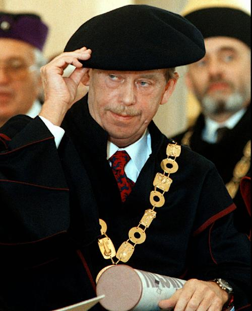 FILE - Czech President Vaclav Havel holds an honorary doctorate of the Academy of Performing Arts (AMU) in Prague that was conferred to him in this Oct. 4, 1996 file photo. Havel, the dissident playwright who wove theater into politics to peacefully bring down communism in Czechoslovakia and become a hero of the epic struggle that ended the Cold War, died Sunday Dec. 18, 2011 in Prague. He was 75. (AP Photo/Michal Dolezal/CTK, File)