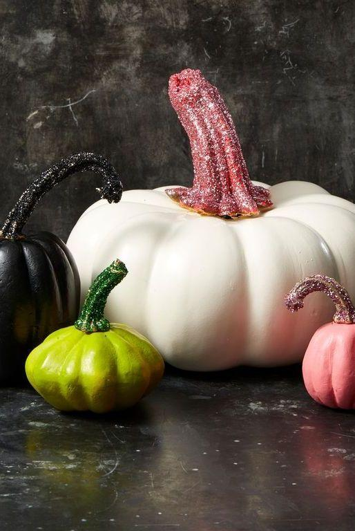 """<p>Why settle for plain pumpkins when you can go for a touch of glam? Simply paint your pumpkins and dip the stems in eye-catching glitter.  </p><p><a class=""""body-btn-link"""" href=""""https://go.redirectingat.com?id=74968X1596630&url=https%3A%2F%2Fwww.etsy.com%2Flisting%2F749376061%2F1oz-fine-loose-glitter-164-size-shimmer&sref=https%3A%2F%2Fwww.goodhousekeeping.com%2Fholidays%2Fhalloween-ideas%2Fg33437890%2Fhalloween-table-decorations-centerpieces%2F"""" target=""""_blank"""">SHOP GLITTER</a></p>"""