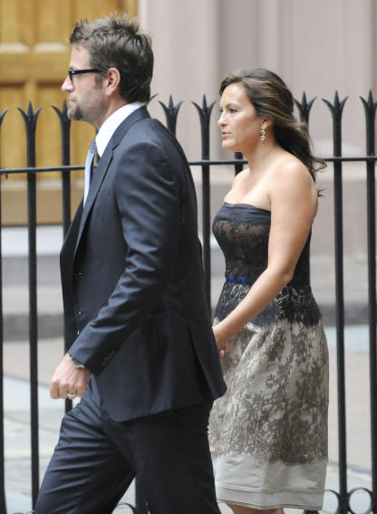 Actress Mariska Hargitay and husband Peter Hermann enter St. Patricks Old Cathedral before the wedding of Alec Baldwin and Hilaria Thomas in New York on Saturday, June 30, 2012. (AP Photo/ Louis Lanzano)