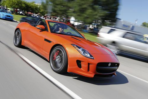 This undated publicity photo provided by Jaguar Land Rover North America, LLC shows a 2014 Jaguar F Type. The two-seat, rear-wheel-drive sports convertible was unveiled at the Paris auto show in 2012 and went on sale in the U.S. earlier this summer. Jaguar says the F Type has the company's most advanced use of lightweight aluminum to date, giving it a stiffer and more dynamic ride. (AP Photo/Jaguar Land Rover North America, LLC, Regis Lefebure)