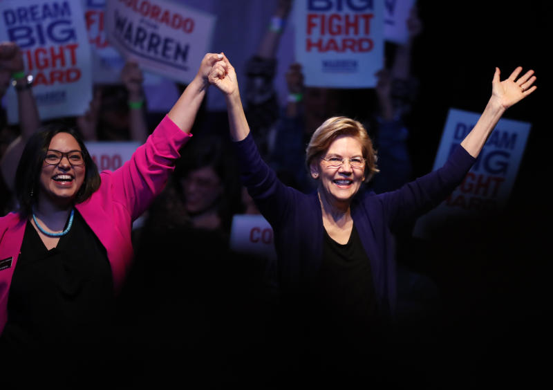 Democratic presidential candidate Sen. Elizabeth Warren, D-Mass., right, acknowledges the crowd with Colorado State Sen. Julie Gonzalez, D-Denver, before speaking at a campaign rally Sunday, Feb. 23, 2020, in Denver. (AP Photo/David Zalubowski)