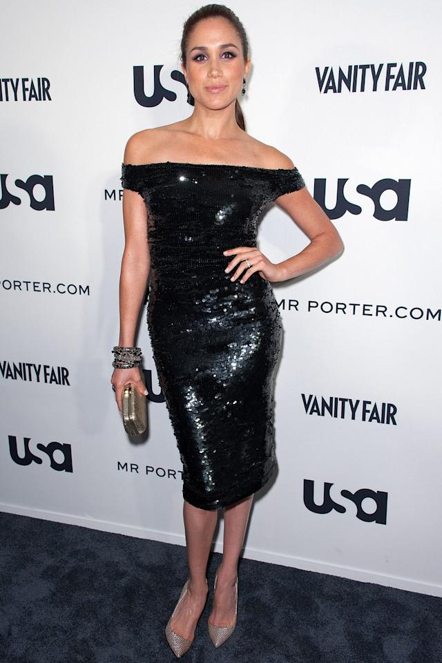 <p>Meghan attended the Suits Story fashion show in NYC wearing a sequined off-the-shoulder midi dress with mixed-metal accessories.<br><br></p>