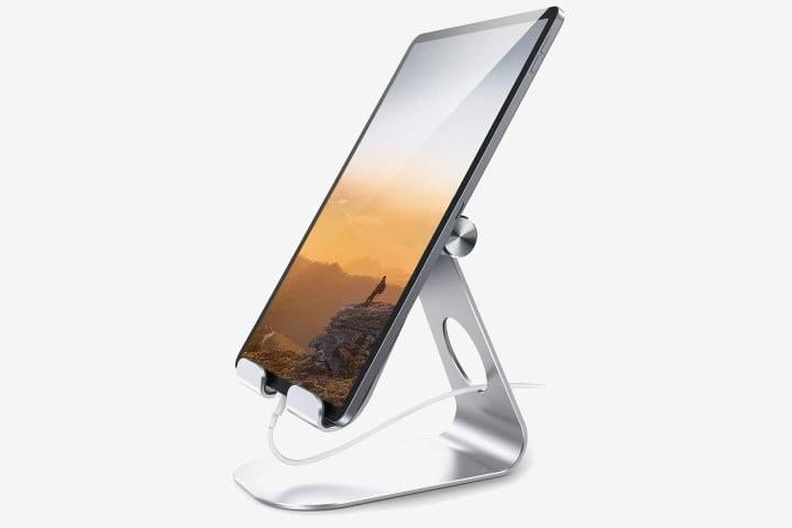 Photo shows a tablet in a Lamicall silver tablet stand