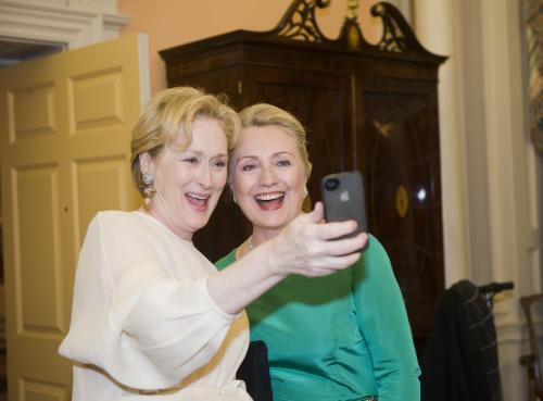 "File - In this Saturday, Dec. 1, 2012, file photo Actress Meryl Streep uses her IPhone to take a photo of her and Secretary of State Hillary Rodham Clinton following the State Department Dinner for the Kennedy Center Honors gala at the State Department in Washington. ""Selfie"" the smartphone self-portrait has been declared word of the year for 2013 by Britain's Oxford University Press. (AP Photo/Kevin Wolf, File)"