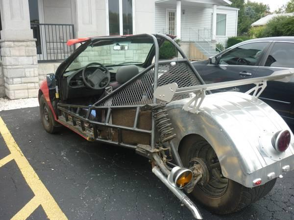 This three-wheeler is a Chevrolet Cavalier with a mullet