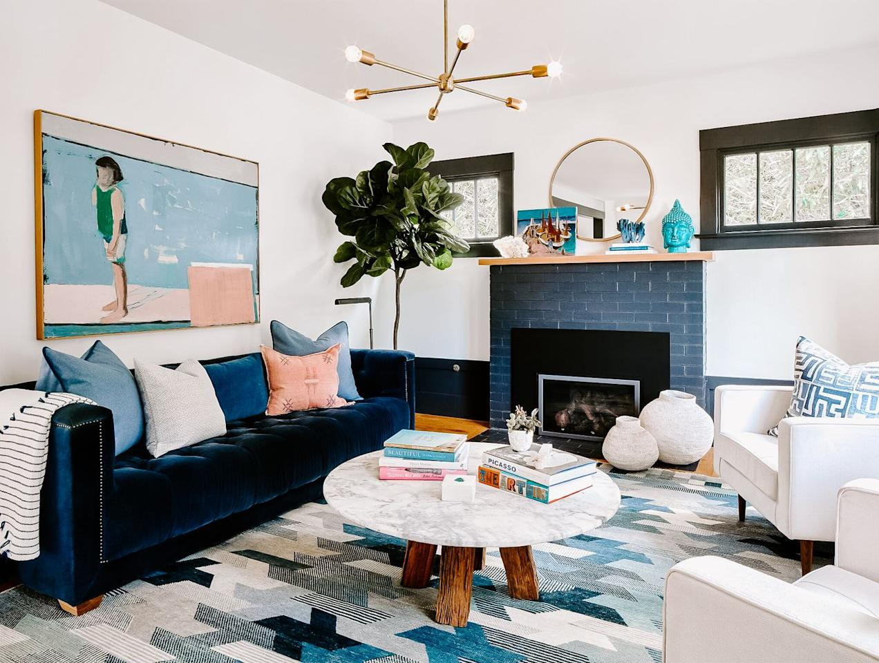 "<p>Shades of blue and pops of pink create a serene contemporary atmosphere in this space from <a href=""https://deringhall.com/interior-designers/lark-palm"">Lark + Palm</a>.</p>"