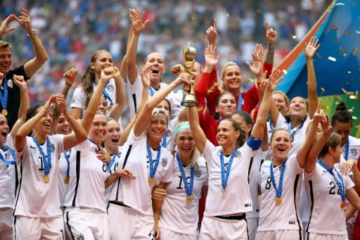 USA players hold aloft the World Cup trophy after winning the 2015 tournament in Canada