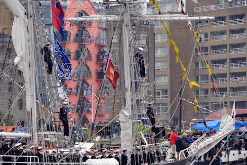 Sea Cadets onboard TS Royalist man the masts and line the decks as the Royal Barge turns towards HMS President, during the Royal flotilla to celebrate Britain's Queen Elizabeth II's golden jubilee, on the river Thames in London, Sunday June 3, 2012. Her Majesty The Queen and His Royal Highness The Duke of Edinburgh were onboard the Royal Barge, the Spirit of Chartwell with several other members of the Royal Family to celebrate the Queen's Diamond Jubilee at the River Pageant on the Thames.(AP Photo/MOD Royal Navy) The Royal Barge was accompanied by the Royal Barge Honour Guard made up of two P2000 patrol boats, two picket boats, two rigid inflatable boats from HMS Diamond, and four Off-shore Raiding Craft from 539 Assault Squadron Royal Marines. The Massed Bands of Her Majesty's Royal Marines piped the boats down the river as they sailed behind the Royal Barge before Her Majesty The Queen was escorted by the First Sea Lord, Sir Mark Stanhope into HMS President, where the Royal Party then watched as the remaining boats sailed past. Portsmouth-based Minehunter HMS Hurworth was the Royal Navy's contribution to the Pageant while the Royal Naval Reserves formed a Guard of Honour and Colour party at HMS President to receive the Queen. This was the first time the Colour had been presented in the presence of the Queen since it was presented the year following her Golden Jubilee. To round the whole pageant off, the Fleet Air Arm staged a flypast in a diamond formation over HMS President – with nine Royal Navy helicopters led by a Second World War Swordfish.