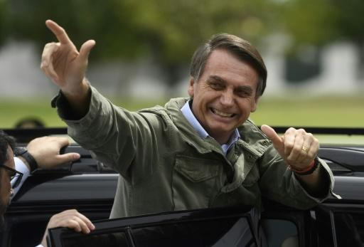 Jair Bolsonaro gives thumbs up to supporters after voting in the second round of the Brazil's presidential elections on October 28, 2018