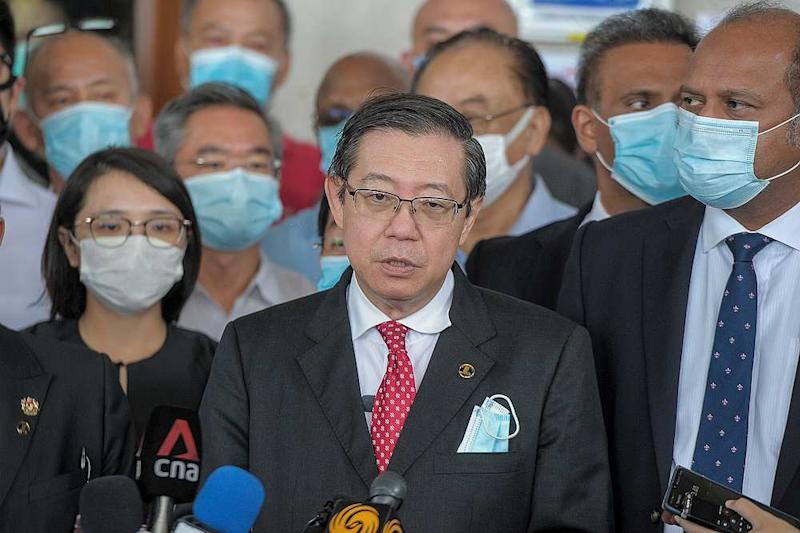 Former Penang chief minister Lim Guan Eng speaks to reporters at the Kuala Lumpur Court complex August 7, 2020. — Picture by Shafwan Zaidon