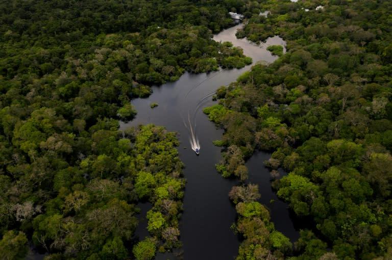 A boat speeds down the Jurura River in the Brazilian Amazon