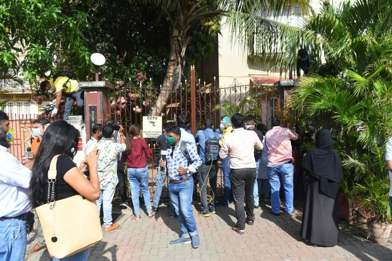 Media people gather in front of the Mumbai residence of Bollywood heartthrob Sushant Singh Rajput after the news broke of his death