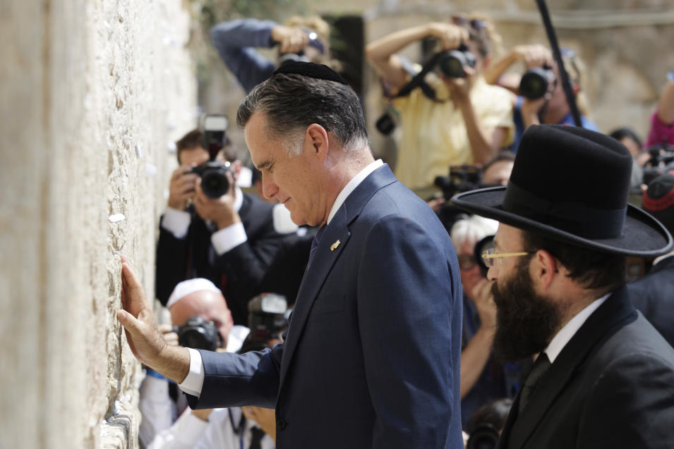 Republican presidential candidate and former Massachusetts Gov. Mitt Romney pauses next to the Western Wall, in Jerusalem, Sunday, July 29, 2012. (AP Photo/Dan Balilty)