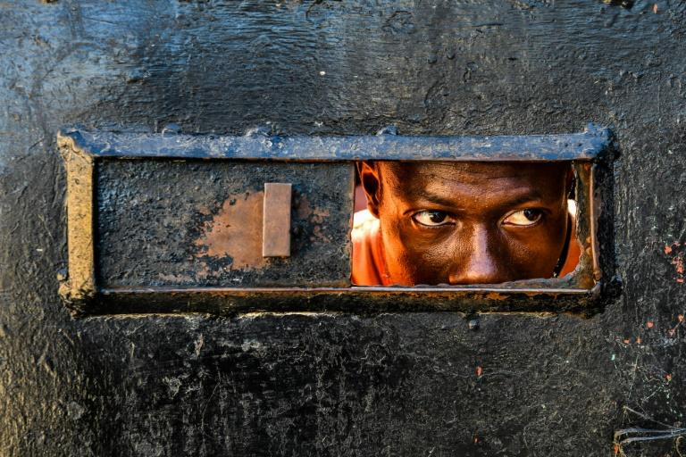 A man looks inside the Orphanage of the Church of Bible Understanding on February 14, 2020, where a fire broke out the previous night in the Kenscoff area outside of Port-au-Prince