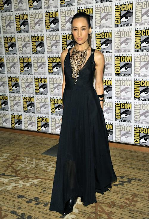 """Maggie Q attends the """"Divergent"""" press line on Day 2 of Comic-Con International on Thursday, July 18, 2013 in San Diego, Calif. (Photo by Chris Pizzello/Invision/AP)"""