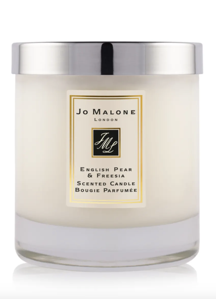 "<p><strong>Jo Malone London</strong></p><p>saksfifthavenue.com</p><p><strong>$67.00</strong></p><p><a href=""https://go.redirectingat.com?id=74968X1596630&url=https%3A%2F%2Fwww.saksfifthavenue.com%2Fjo-malone-london-english-pear-freesia-home-candle%2Fproduct%2F0472220191330&sref=https%3A%2F%2Fwww.cosmopolitan.com%2Flifestyle%2Fg31781788%2Fbest-scented-candles-reviews%2F"" target=""_blank"">Shop Now</a></p><p>Jo Malone packaging is *chef's kiss* perfection. You'll receive this fruity floral one nestled in a fancy box tied with a ribbon. It's not weird if you want to use the box as decor, just sayin'.</p>"