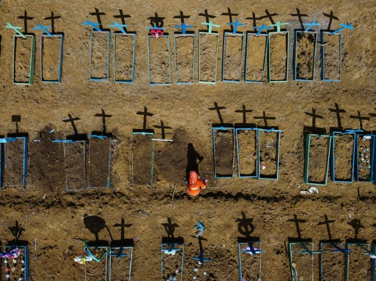A gravedigger burying a person at the Nossa Senhora Aparecida cemetery in the neighbourhood of Taruma, in Manaus, Brazil, on June 2, 2020 during the COVID-19 pandemic