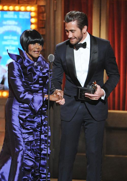 "Cicely Tyson, left, winner of the Tony Award for best actress in a play for ""The Trip to Bountiful,"" is assisted by presenter Jake Gyllenhaal at the 67th Annual Tony Awards, on Sunday, June 9, 2013 in New York. (Photo by Evan Agostini/Invision/AP)"