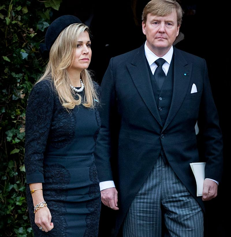 King Willem-Alexander and Queen Maxima looking sad at funeral wearing black clothes