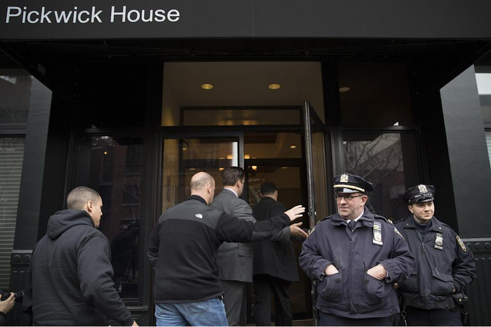 Police stand guard outside the home of actor Philip Seymour Hoffman who was found dead in his Greenwich village apartment, Sunday, Feb. 2, 2014, in New York. He was 46. (AP Photo/John Minchillo)