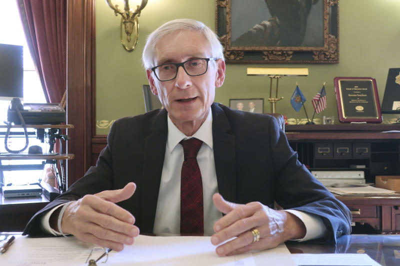 """Wisconsin Gov. Tony Evers speaks during an interview with The Associated Press Wednesday, Dec. 4, 2019 in his Statehouse office in Madison, Wis. Evers says that in the wake of two school shootings at separate Wisconsin high schools the """"state has to step up and help"""" school districts provide more mental health services for students. Evers spoke about his hope to work with Republicans to secure more funding. (AP Photo/Scott Bauer )"""