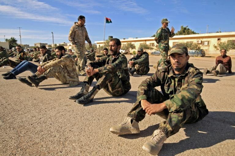 Fighters of a battalion loyal to Libyan General Khalifa Haftar pictured in the eastern city of Benghazi in December 2019. Both sides in Libya's conflict agreed to a ceasefire that started early Sunday