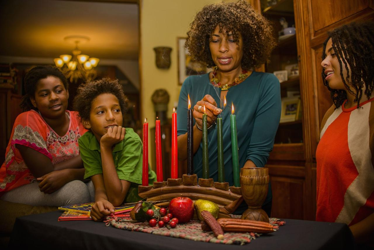 "<p>While Kwanzaa has gained mainstream popularity in recent years, for white people and non-Black people of color, the week-long holiday is still relatively unknown.<strong> [</strong>Some people may not even know that <a href=""https://www.history.com/topics/holidays/kwanzaa-history"" target=""_blank"">Kwanzaa wasn't established until the 1960s</a>.<strong>]I WOULD CUT THIS</strong> The annual holiday celebrating African-American culture was created by American professor Dr. Maulana Karenga in 1966, following the <a href=""https://www.history.com/topics/1960s/watts-riots"" target=""_blank"">Watts Riots of 1965</a>. Dr. Karenga's goal was to give Black people an opportunity to celebrate themselves and their history, and the name Kwanzaa was inspired by the Swahili phrase <em>matunda ya kwanza</em>, meaning ""first fruits of the harvest."" Kwanzaa may have become more commercialized over the past 54 years, but not everyone is familiar with the traditions of Kwanzaa and why they're so special. </p><p>From lighting candles to exchanging gifts, Kwanzaa bears a similarity to other winter holidays (though, when celebrating Kwanzaa, the presents aren't nearly as important as the traditions). Here are all the Kwanzaa traditions that take place between December 26 and January 1.</p>"