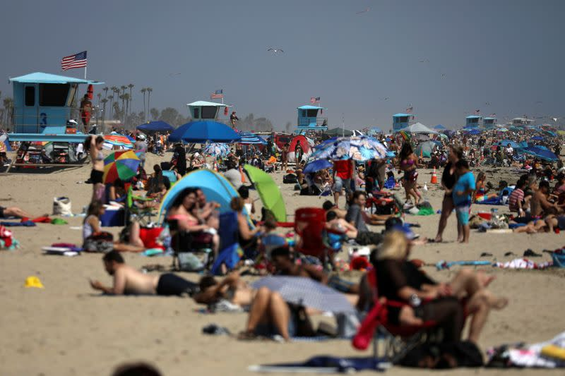 People visit the beach on Memorial Day weekend during the outbreak of the coronavirus disease (COVID-19) in Huntington Beach, California