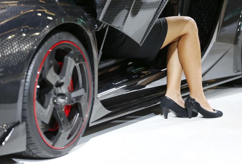 A model sits inside a Lamborghini car modified by Mansory luxury car tuning company during a media preview day at the Frankfurt Motor Show