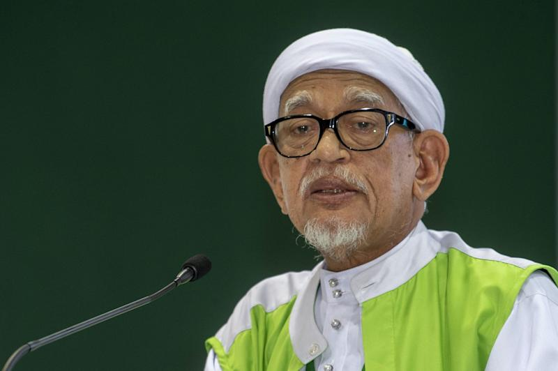PAS President Datuk Seri Abdul Hadi Awang delivering the opening speech of the 66th PAS Annual Congress at the Kelantan Islamic Education Center in Pengkalan Chepa September 13, 2020. — Bernama pic