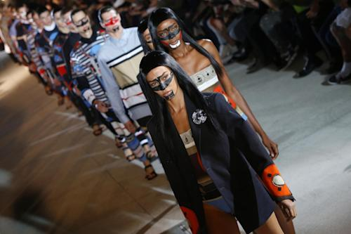 Models present creations as part of the Givenchy men's fashion Spring-Summer 2014 collection, presented Friday, June 28, 2013 in Paris. (AP Photo/Francois Mori)