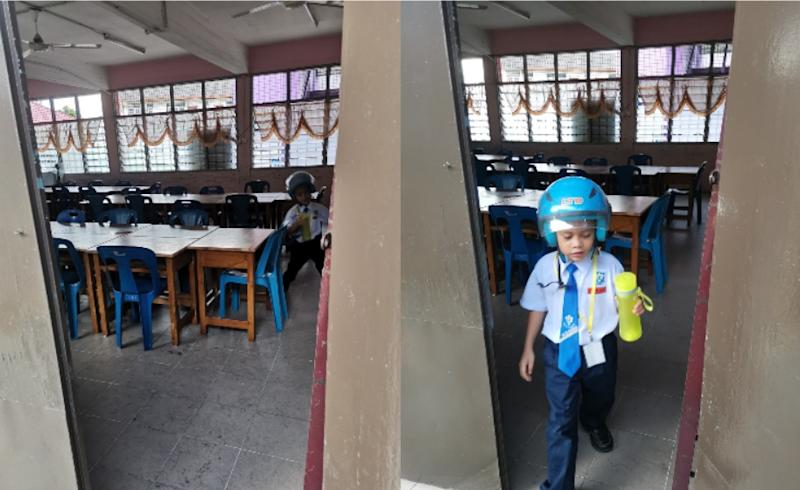 Fadli's son, Asyraff, quickly runs back out of class once retrieving his bottle. — Picture via Facebook/Mohd Fadli Salleh.