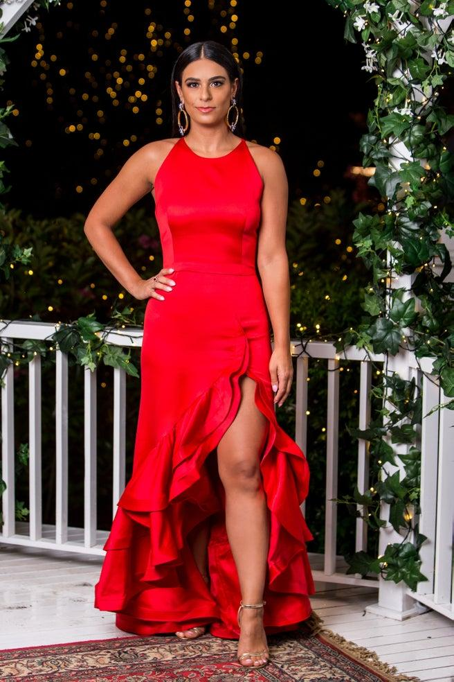 Danush Deravi in a red dress on opening night of The Bachelor Australia
