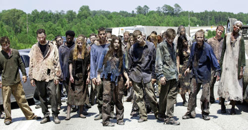 "FILE - In this image released by AMC, zombies appear in a scene from the second season of the AMC original series, ""The Walking Dead,"" in Senoia, Ga. The series' fourth season premieres on Oct. 13. Crews have been filming the new episodes in Georgia, but they keep locations of future episodes closely-guarded secrets until the shows air. In Grantville, Ga., the town's ruins were featured prominently last season. In nearby Senoia, many scenes are filmed in the historic downtown area, transforming into the fictional town of Woodbury for the show. (AP Photo/AMC, Gene Page) NO SALES"