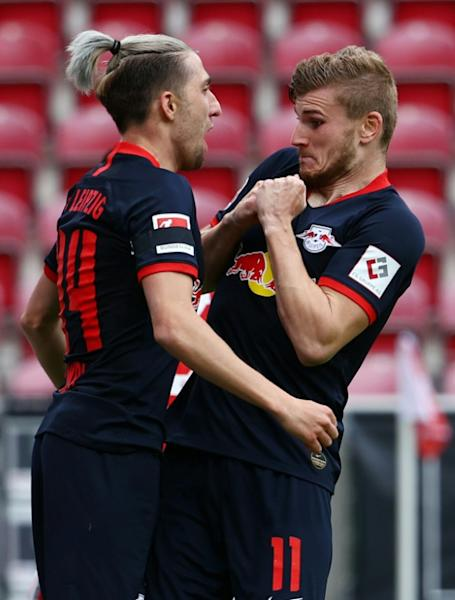 No touching: Leipzig's Timo Werner celebrates his hat-trick with teammate Kevin Kampl while observing social distancing
