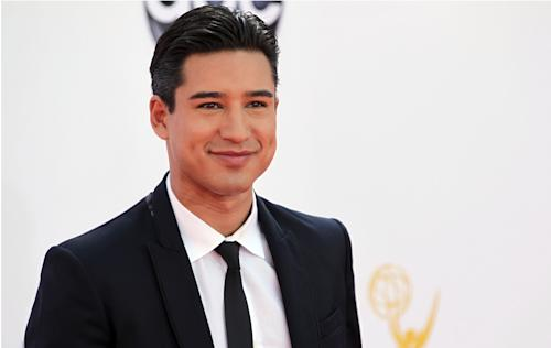 "FILE - In this Sept. 23, 2012 file photo, Mario Lopez arrives at the 64th Primetime Emmy Awards at the Nokia Theatre, in Los Angeles. ""Extra"" host, Mario Lopez and ""Keeping Up with the Kardashians,"" co-star, Khloe Kardashian Odom, will host the second season of the Fox talent competition, ""The X-Factor."" The network said Tuesday, Oct. 16, 2012, that Odom and Lopez will first appear as hosts during the show's live broadcasts beginning this November. (Photo by Matt Sayles/Invision/AP, File)"