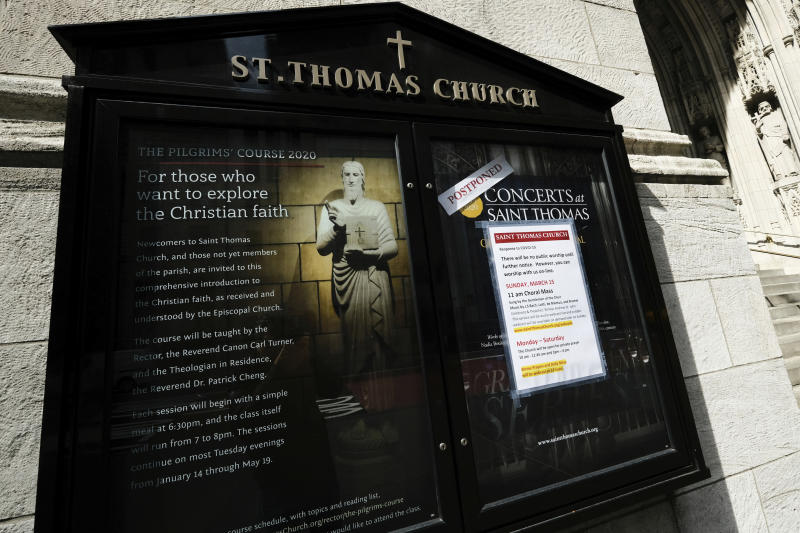 FILE- In this March 18, 2020 file photo, a sign posted at St. Thomas Church in New York announces that public services are postponed due to coronavirus concerns. On Friday, June 26, 2020, a federal judge in New York blocked the state from enforcing coronavirus restrictions limiting indoor religious gatherings to 25% capacity when other types of gatherings are limited to 50%. (Photo by Evan Agostini/Invision/AP, File)