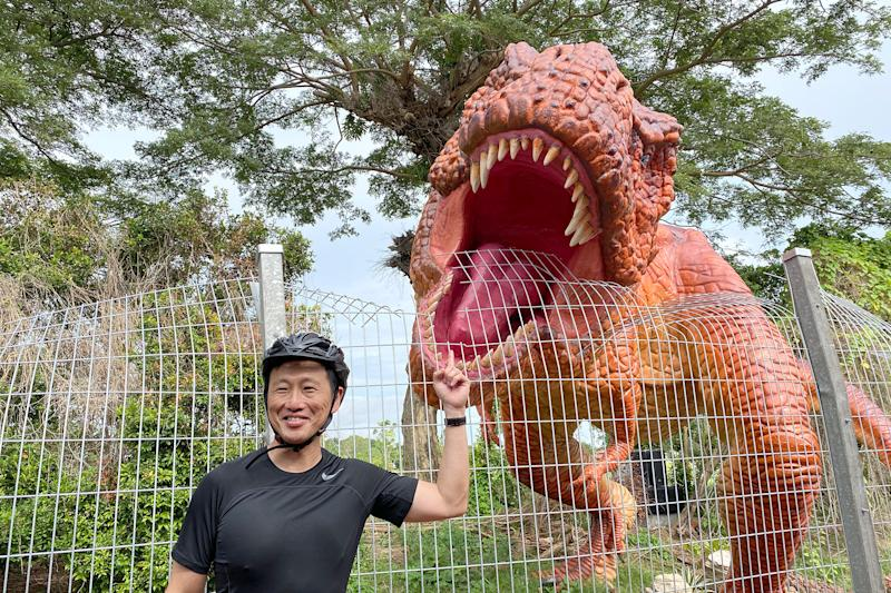 Transport Minister Ong Ye Kung, who officiated the launch of the Changi Airport Connector on Sunday (11 October), posing with a Tyrannosaurus Rex display. (PHOTO: Dhany Osman / Yahoo News Singapore)