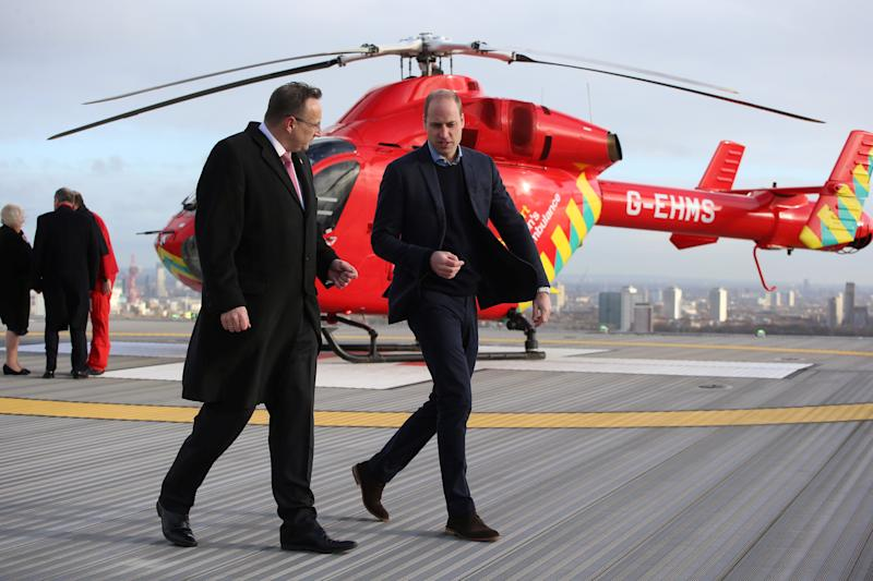 Britain's Prince William, Duke of Cambridge (R), walks across the helipad after arriving in a red London Air Ambulance at the Royal London Hospital in east London on January 9, 2019. - The Duke of Cambridge visited London's Air Ambulance to recognise the work that the organisation's first responders carry out delivering life-saving treatment across London. (Photo by Ian Vogler / POOL / AFP) (Photo credit should read IAN VOGLER/AFP/Getty Images)
