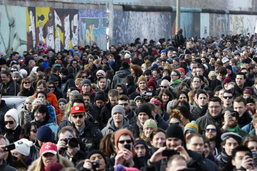 "Thousands of protesters follow a truck with US actor David Hasselhoff as he attends a protest against the removal of a section of the historic part of the East Side Gallery named part of the former Berlin Wall, in Berlin, Sunday, March 17, 2013. Hasselhoff is fondly remembered by many Germans for releasing a song called ""Looking for Freedom"" shortly before the fall of the Wall in 1989. (AP Photo/Markus Schreiber)"
