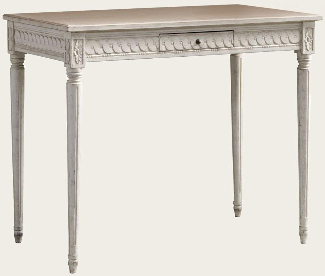 """<p><strong></strong></p><p>chelseatextiles.com</p><p><strong>$103.00</strong></p><p><a href=""""https://www.chelseatextiles.com/us/furniture/gustavian/rectangle-table-with-carving-one-drawer-wood-top"""" target=""""_blank"""">Shop It</a></p><p>This desk is a Gustavian-inspired little treasure. Delicate carvings with painted details create a standout piece, making it just as gorgeous in a modern home as a traditional one.</p>"""