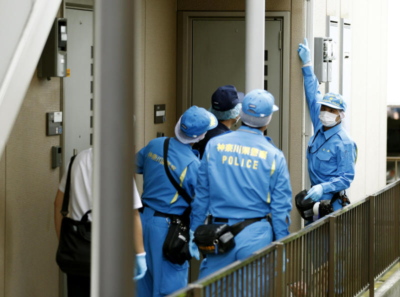 Police investigators head to the house of suspect Ayumi Kuboki in Yokoham, which was raided by Japanese authorities on Thursday, July 12, 2018.