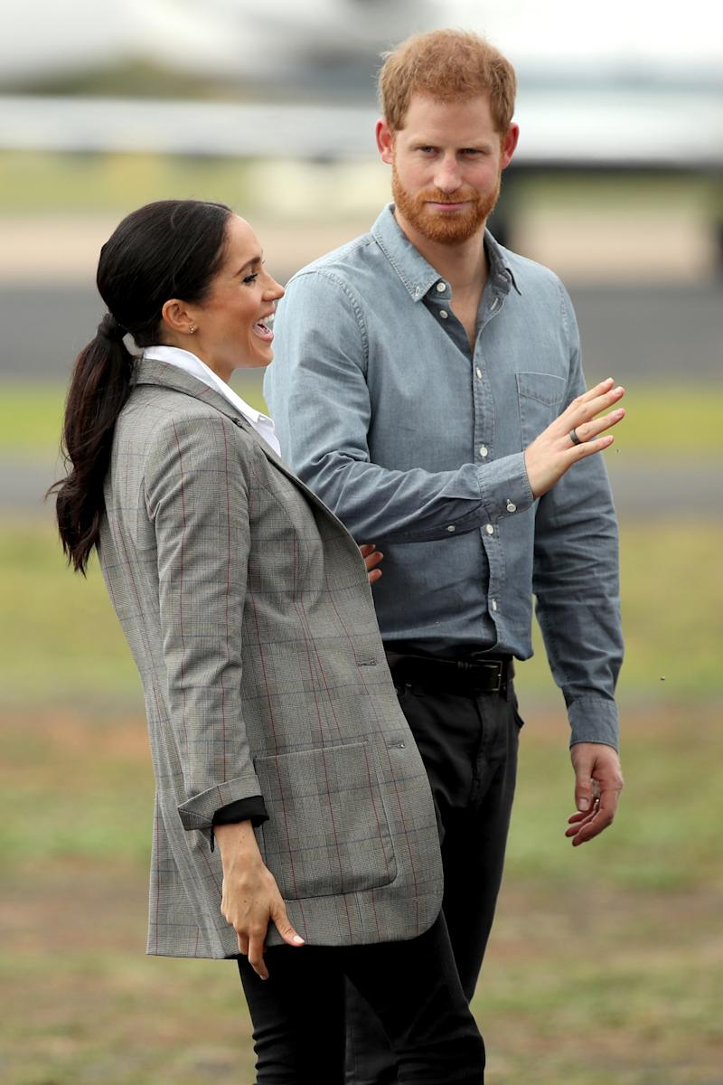 Meghan wears her hair in a ponytail for day two of the tour. Photo: Getty, meghan markle prince harry dubbo, meghan markle prince harry australia, meghan markle serena williams jacket, meghan markle pregnant