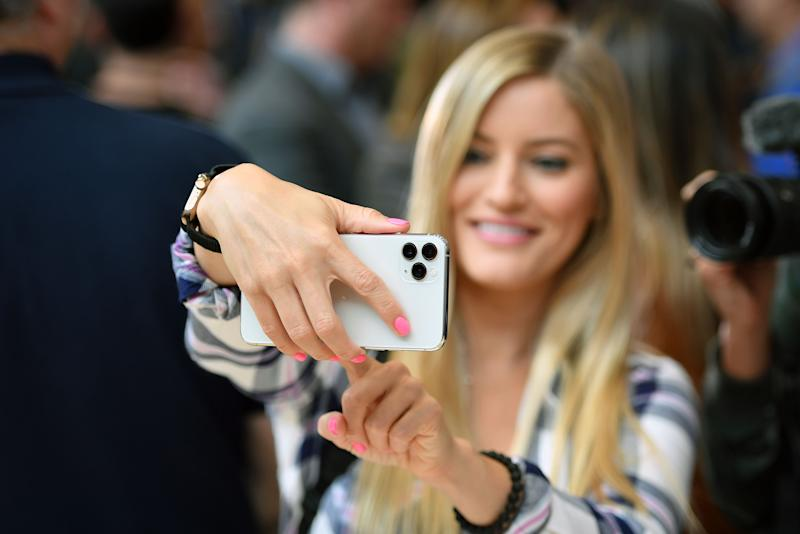 A woman tries out a new Apple 11 Pro during an Apple product launch event at Apple's headquarters in Cupertino, California.