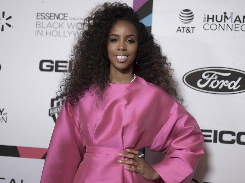 """FILE - This Feb. 21, 2019 file photo shows Kelly Rowland at the 12th Annual ESSENCE Black Women in Hollywood Awards in Beverly Hills, Calif. Rowland says her new single """"Coffee"""" and its accompanying music video is her """"ode to the beauty of black women."""" She debuted the breezy R&B track and video featuring black women across a spectrum of shades and colors two weeks ago. (Photo by Richard Shotwell/Invision/AP, File)"""