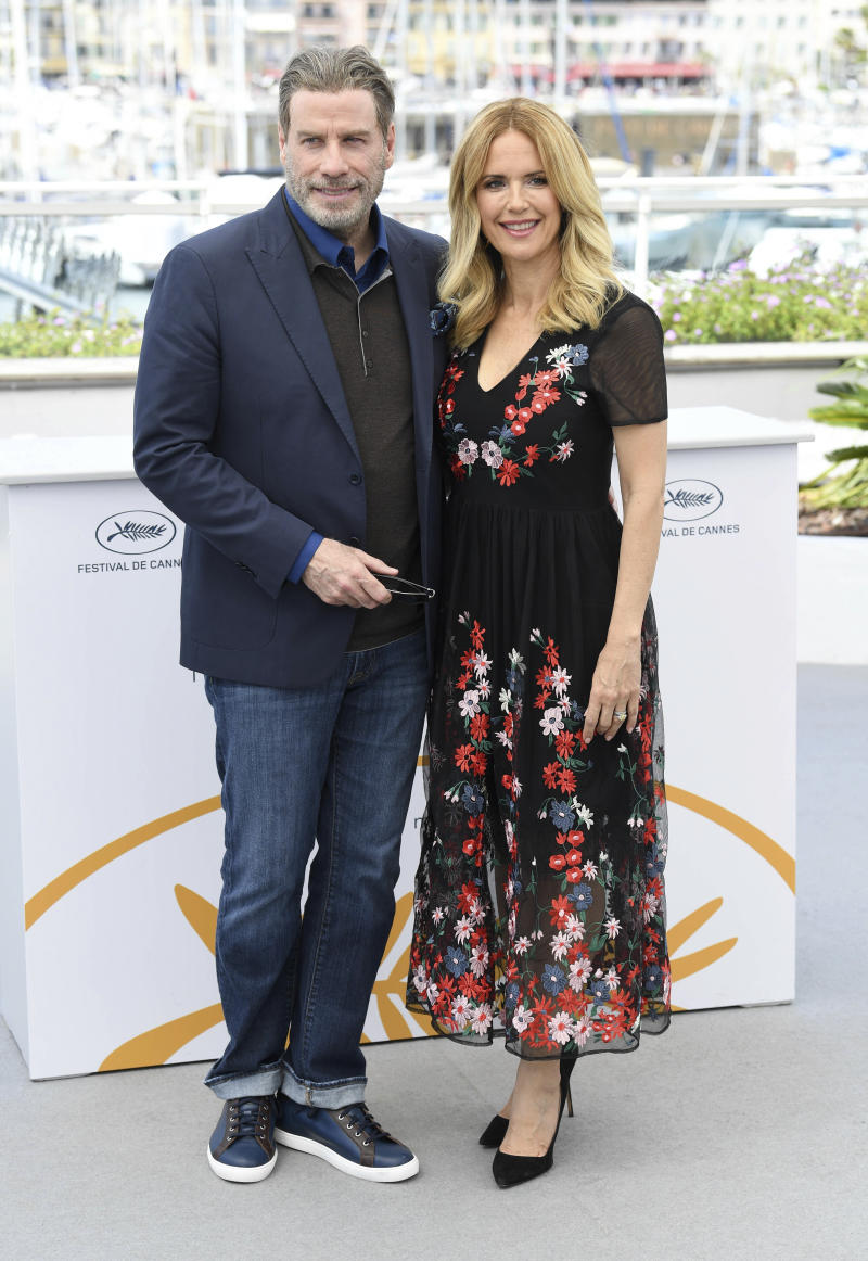 """Photo by: 2020 7/13/20 Kelly Preston, wife of John Travolta, has passed away at age 57, after a two-year battle with breast cancer. STAR MAX File Photo: 5/15/18 John Travolta and Kelly Preston at a photocall for """"Gotti"""" at the Palais De Festival, part of the 71st Cannes Film Festival. (Cannes, France)"""