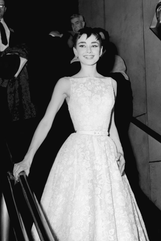 """<p>At the 1954 Oscars in New York City, Hepburn wore this tea-length Givenchy number. It was sold for a little under <a href=""""https://financesonline.com/10-most-expensive-dresses-worn-by-celebrities-at-the-academy-awards/"""" target=""""_blank"""">$131,300 in 2011</a>.</p>"""