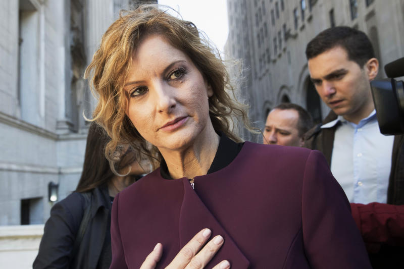 """FILE - In this Oct. 18, 2018, file photo, Summer Zervos leaves New York state appellate court in New York. Records filed in Zervos' defamation suit and obtained Monday, Nov. 4, 2019, by The Associated Press indicate that Zervos, a former """"Apprentice"""" contestant, got a call from Trump's phone on Dec. 21, 2007, when she says he rang to invite her to dinner. She says she went for career advice and was sexually assaulted. Trump lawyer Marc Kasowitz said Monday that Zervos' claims """"are entirely meritless and not corroborated by any documents."""" (AP Photo/Mary Altaffer, File)"""